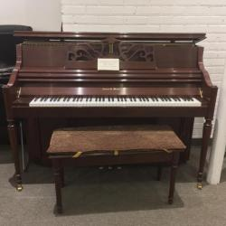 Charles Walter traditional studio piano in a medium cherry satin finish