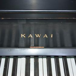 Used Kawai Upright piano with back satin finish.