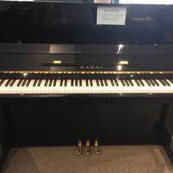 Front view of used Kawai model CX-21D studio piano in ebony polish