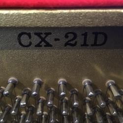 Used Kawai model CX-21D studio piano's model number on plate