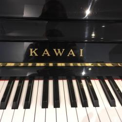 Used Kawai model CX-21D studio piano's name board