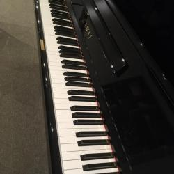Side view of used Kawai model CX-21D studio piano's keys