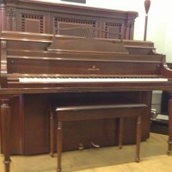 Beautiful Steinway upright piano in excellent condition.