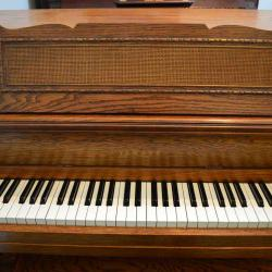 Yamaha Upright console style piano with wood finish-action