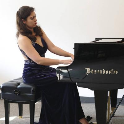 Woman playing Bosendorfer grand piano