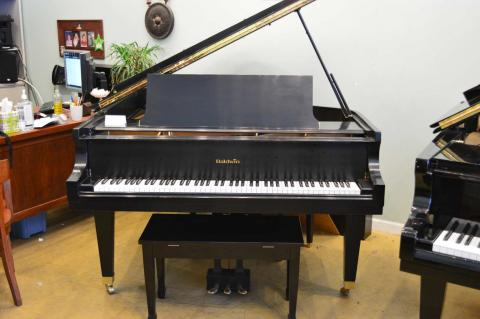 Beautiful Baldwin Grand Piano with an ebony satin finish.