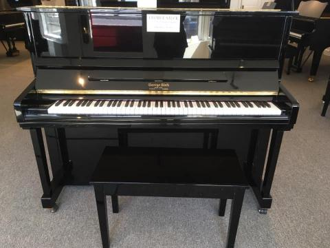 Front of George Steck studio piano in ebony polish